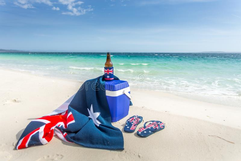 Iconic Australia - beach beer thongs. Iconic Australian items on a beach, esky, beach towel, beer or beverage and thongs. Some items have the Australian flag on royalty free stock photography