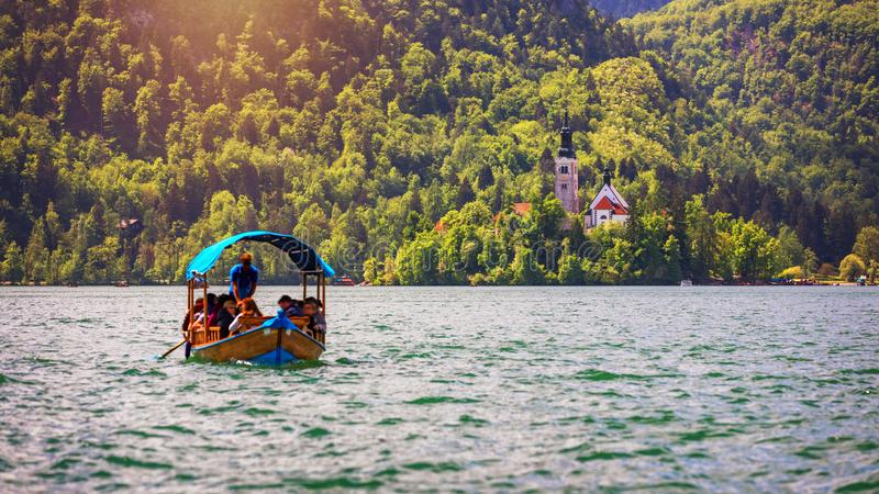 Iconic Bled scenery. Boats at lake Bled, Slovenia, Europe. Wooden boats on the Island on Lake Bled, Slovenia stock photo