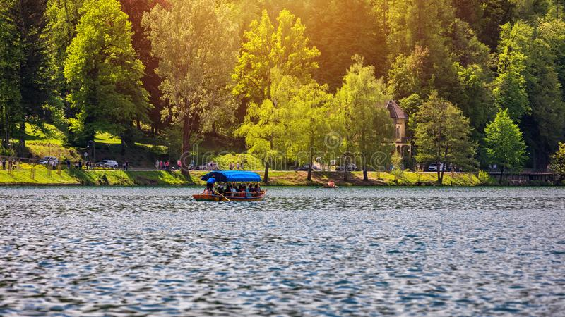 Iconic Bled scenery. Boats at lake Bled, Slovenia, Europe. Wooden boats on the Island on Lake Bled, Slovenia royalty free stock image
