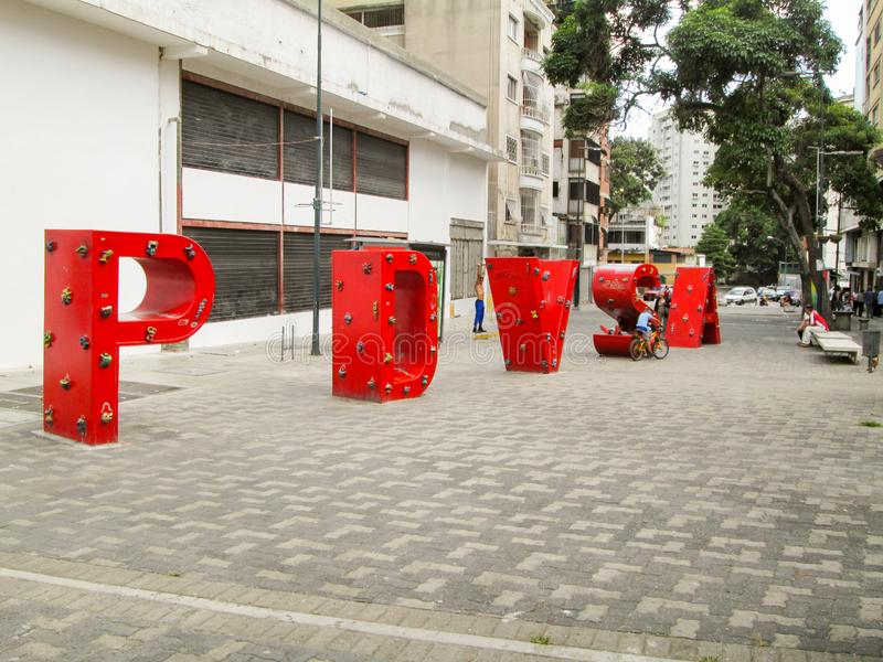 Iconic boulevard in the city of Caracas, Boulevard de Sabana Grande, where you can see the the acronym of PDVSA, Petroleos de Vene. Zuela, Caracas, Venezuela royalty free stock image