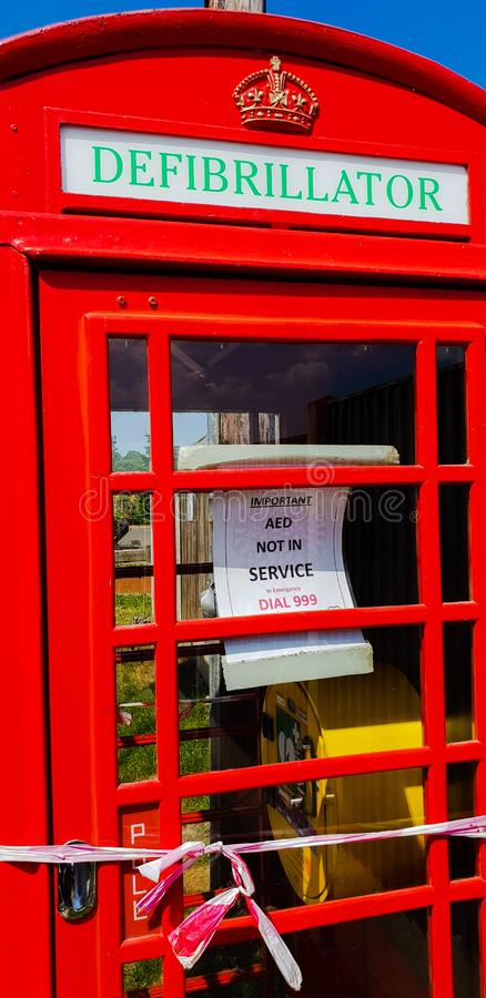 An Iconic British pay phone booth converted to a defibrillator station stock images