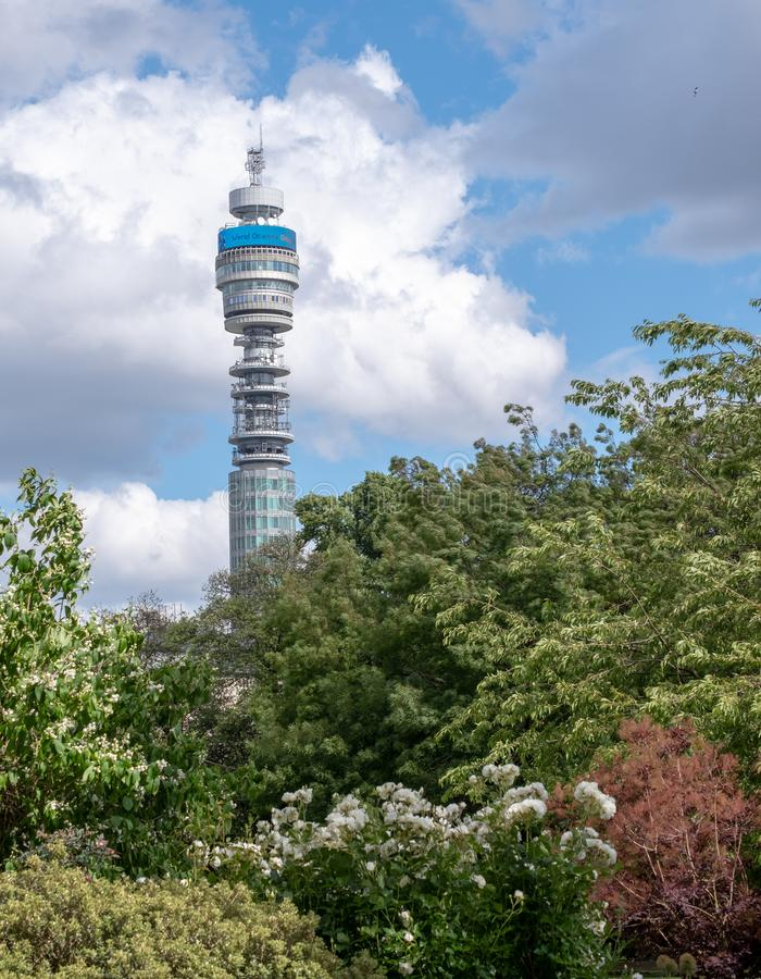 The iconic BT Tower owned by the BT Group, seen from Park Square and Park Cresent gardens, London UK. Photographed during the Open Garden Squares weekend stock photography