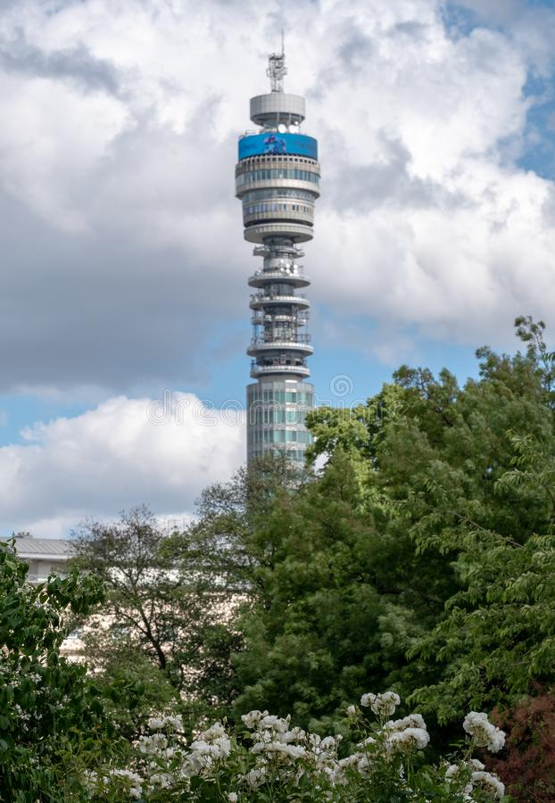 The iconic BT Tower owned by the BT Group, seen from Park Square and Park Cresent gardens, London UK. Photographed during the Open Garden Squares weekend stock photo