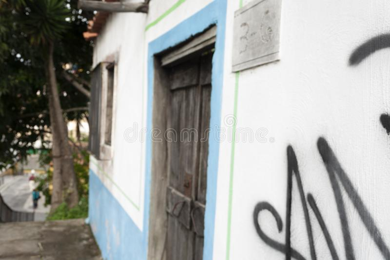 Iconic and colorful old houses and narrow streets typical of El Hatillo, where few people can be seen walking down the street stock photo
