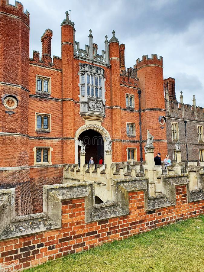 Iconic entrance view of Henry 8th& x27;s Hampton Court Palace with bridge over moat stock images