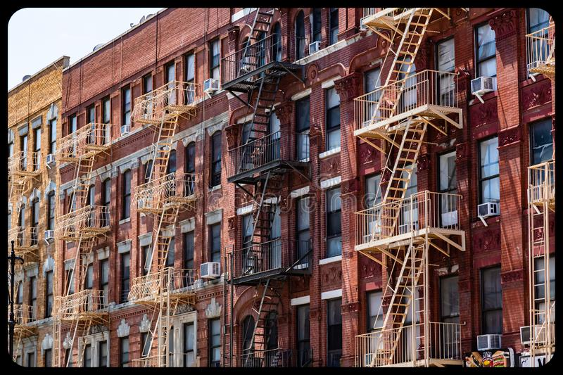 Fire escape ladders on NYC buildings royalty free stock images