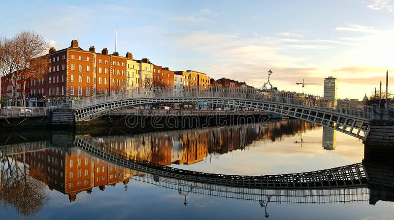 The iconic HaPenny bridge in Dublin city centre, over the River Liffey on a beautiful calm sunny morning. The iconic Ha'Penny bridge in Dublin city centre royalty free stock images
