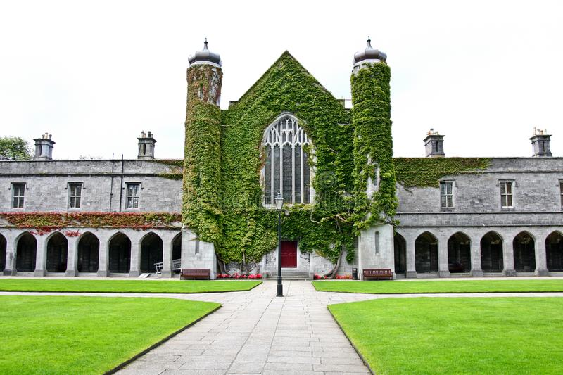 Iconic historic Quadrangle at NUI Galway, Ireland. Part of historic Quadrangle on National University of Ireland Campus. Quadrangle building covered in Ivy with royalty free stock photography