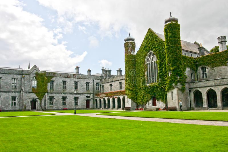 Iconic historic Quadrangle at NUI Galway, Ireland. Part of historic Quadrangle on National University of Ireland Campus. Quadrangle building covered in Ivy with stock images