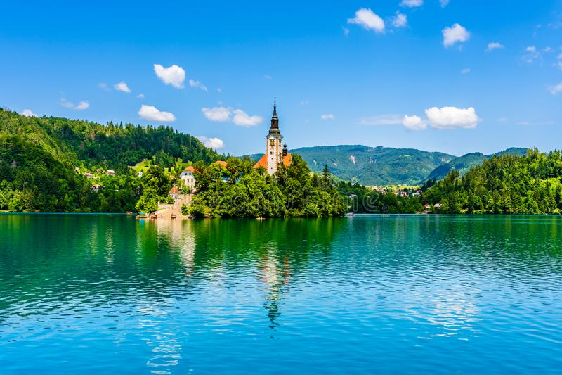Iconic landscape of Lake Bled and the church island in the middle of the lake with water reflections in Bled, Slovenia. Bled, Slovenia: Beautiful iconic stock image