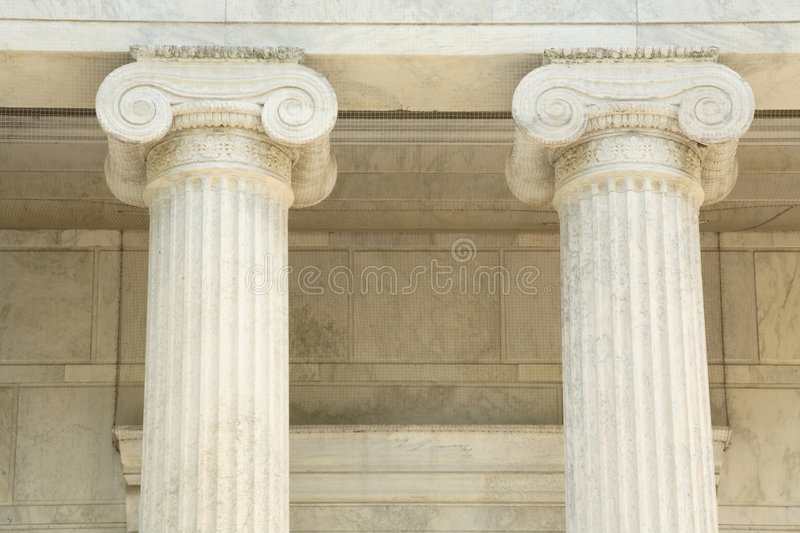 Iconic marble pillars. Tall iconic marble pillars at a governmnent building on the University campus in princeton royalty free stock photography