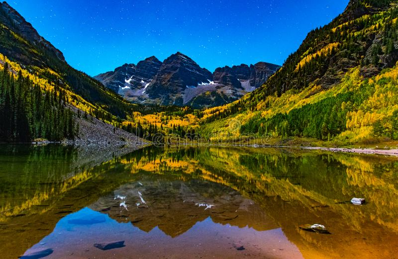 The Iconic Maroon Bells Lit by the Moon During Autumn. A Nighttime Shot of the Popular Maroon Bells With Moonlight Shining on the Mountains royalty free stock photography