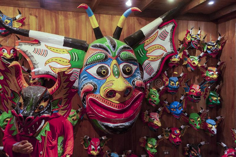 Iconic masks and mannequins wearing costumes from Yare Devils dancing Corpus Christi in a souvenir shop in Venezuela in El Hatillo. An intangible heritage of royalty free stock photography