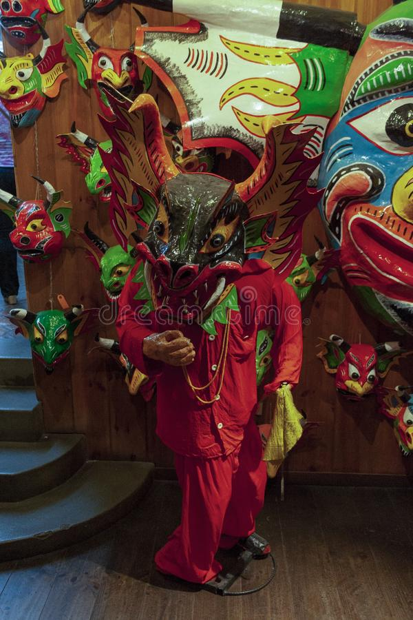 Iconic masks and mannequins wearing costumes from Yare Devils dancing Corpus Christi in a souvenir shop in Venezuela in El Hatillo. An intangible heritage of royalty free stock photos