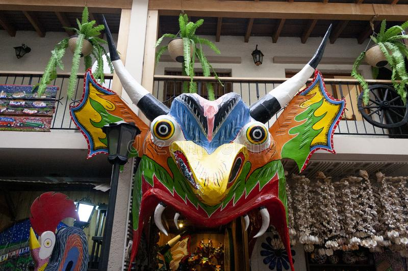 Iconic masks and mannequins wearing costumes from Yare Devils dancing Corpus Christi in a souvenir shop in Venezuela in El Hatillo. An intangible heritage of royalty free stock images
