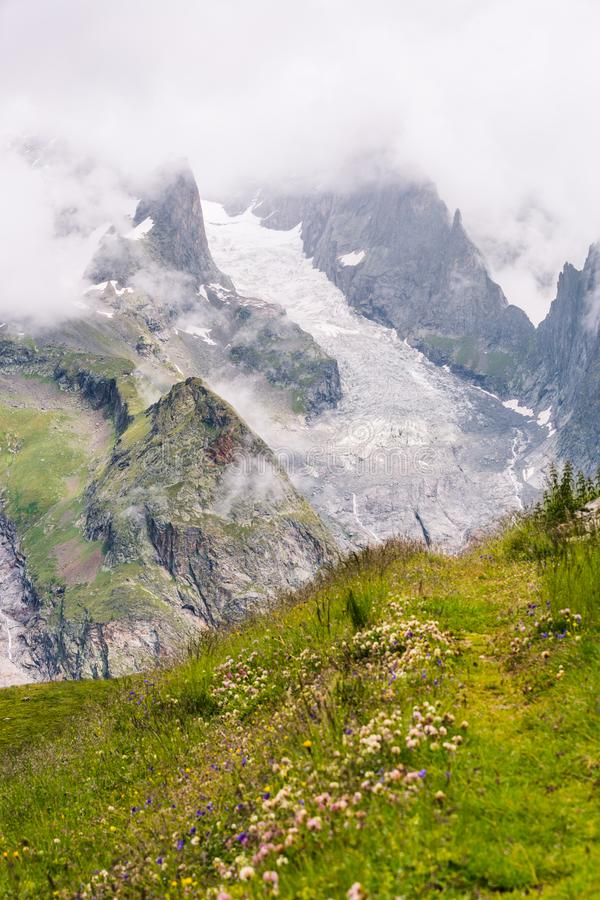Iconic Mont-Blanc Glacier in Clouds in Green Mountain Landscape.  royalty free stock image