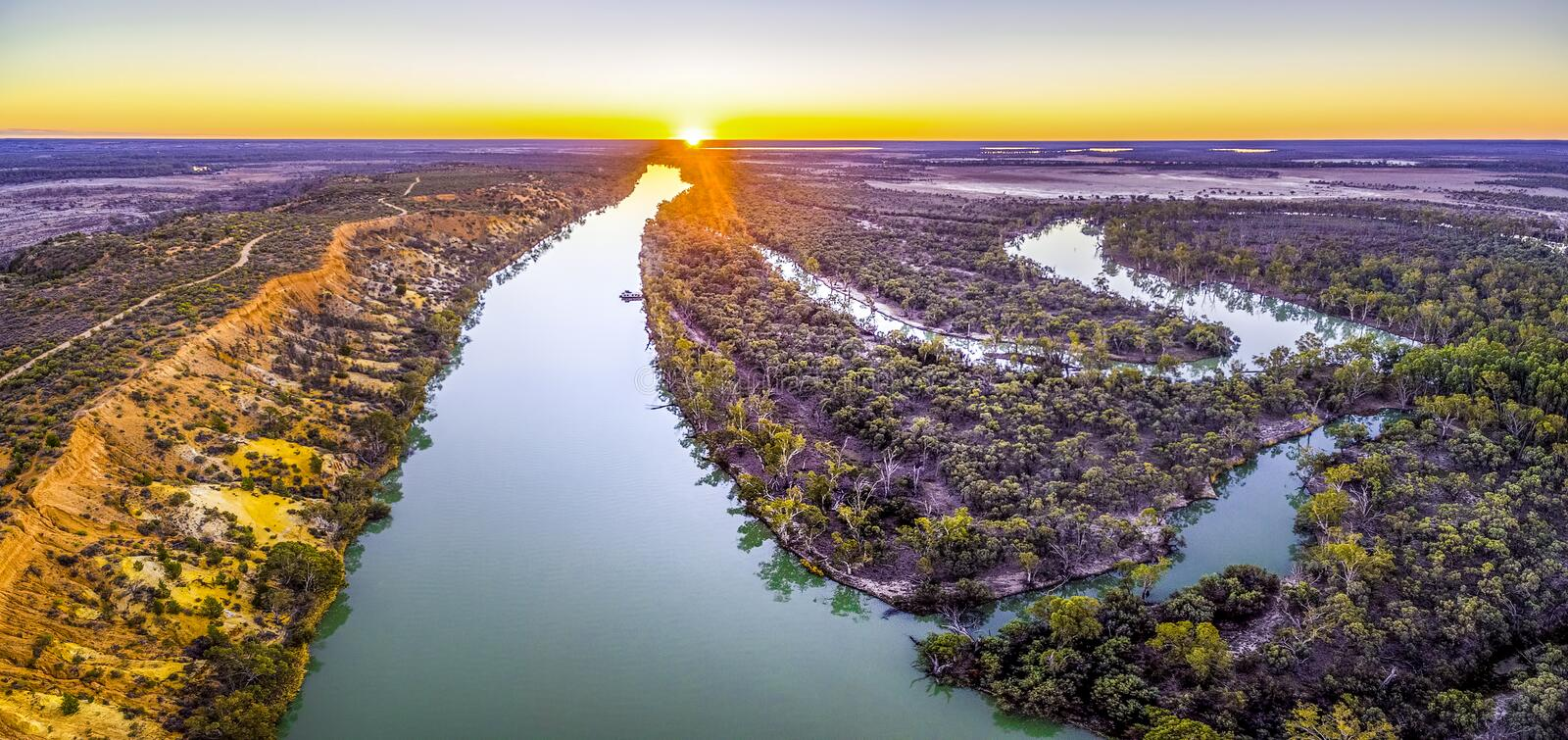 Murray River flowing into the distance aerial panoramic landscape. Iconic Murray River flowing into the distance at beautiful sunset - aerial panoramic stock photo