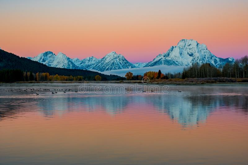 Iconic Oxbow Bend on an Autumn Morning with Colorful Skies and Snow capped Mountains royalty free stock photography