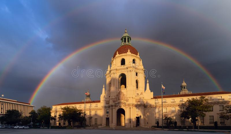 The iconic Pasadena City Hall framed by a Rainbow. The Pasadena City Hall main tower with beautiful clouds and sky, and framed by a rainbow. This is the most stock photography