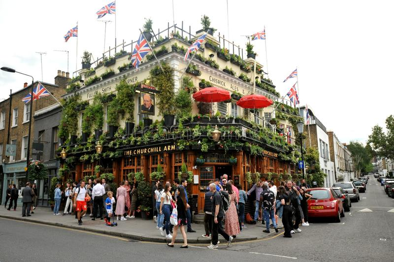 The iconic pub The Churchill`s Arms in London , England stock photos