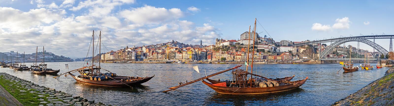 The iconic Rabelo Boats, the traditional Port Wine transports, with the Ribeira District and the Dom Luis I Bridge royalty free stock images
