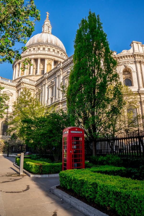 Iconic Red Telephone Booth in St Paul`s Cathedral churchyard in central London royalty free stock photography