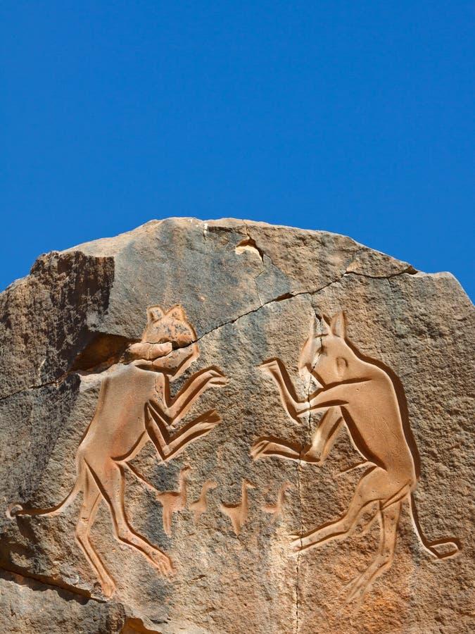 Iconic Rock Engraving, UNESCO World Heritage Site. Iconic Rock Engraving at Wadi Mathendous UNESCO World Heritage Site, Libya royalty free stock photo