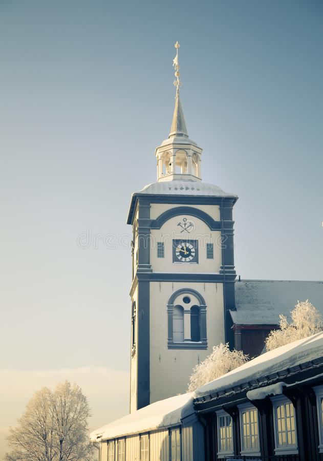 An iconic Roros church in a morning light. Beautiful winter landscape of a small Norwegian town in morning. Scandinavian scenery royalty free stock photos
