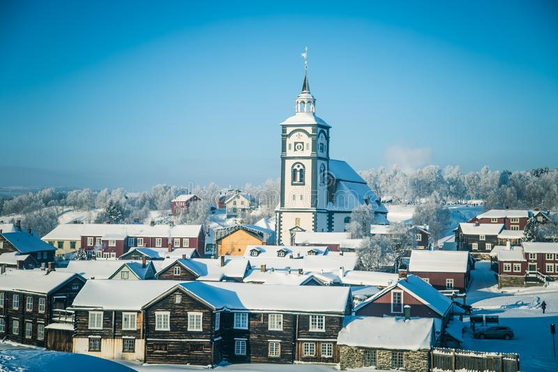An iconic Roros church in a morning light. Beautiful winter landscape of a small Norwegian town in morning. Scandinavian scenery stock image