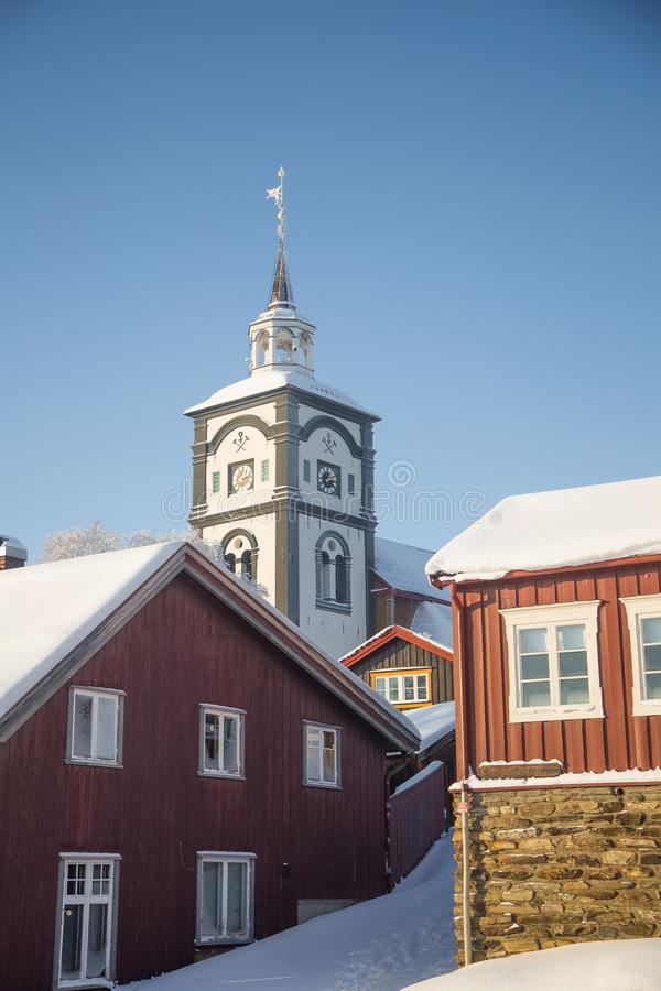 An iconic Roros church in a morning light. Beautiful winter landscape of a small Norwegian town in morning. Scandinavian scenery royalty free stock images