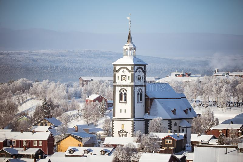An iconic Roros church in a morning light. Beautiful winter landscape of a small Norwegian town in morning. Scandinavian scenery stock photo