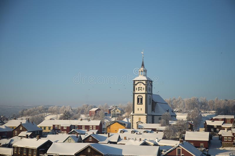 An iconic Roros church in a morning light. Beautiful winter landscape of a small Norwegian town in morning. Scandinavian scenery stock photography