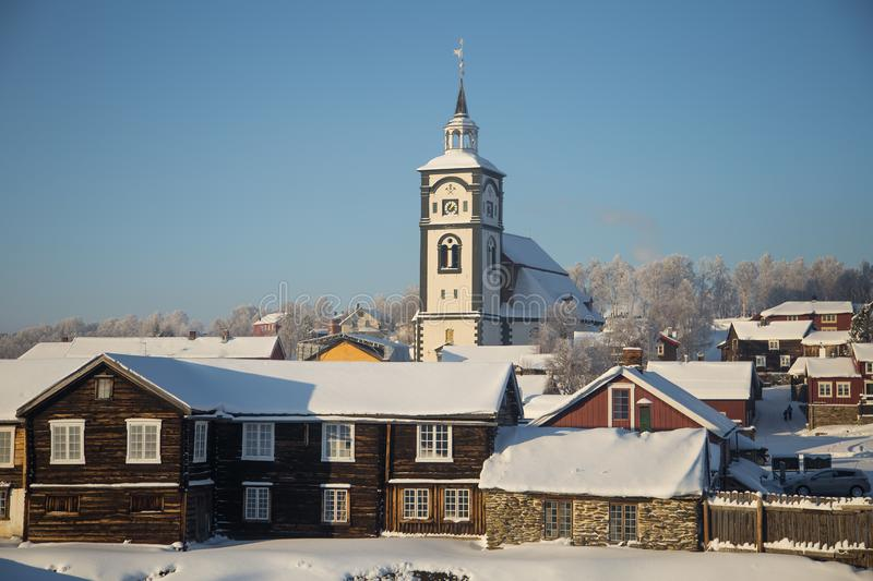 An iconic Roros church in a morning light. Beautiful winter landscape of a small Norwegian town in morning. Scandinavian scenery stock photos