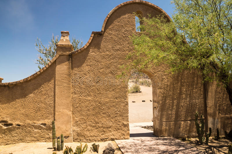 Iconic Spanish Colonial Design. An arched wall and entry to Mission San Xavier shows the distinctice Spanish colonial influence of the architecture stock photography