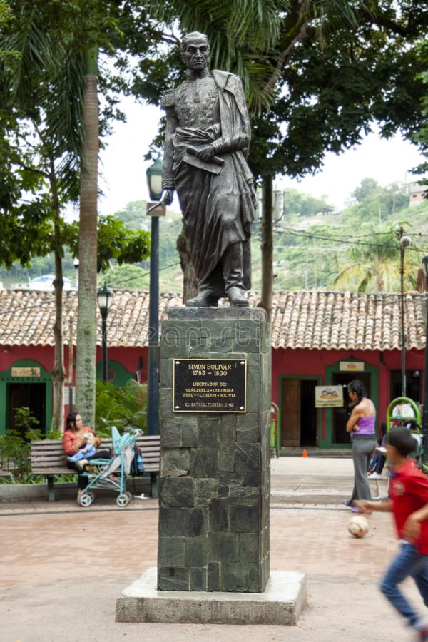 Iconic statue of Simon Bolivar in Plaza Bolivar in El Hatillo and people, children,women and men spending time playing and resting royalty free stock photography