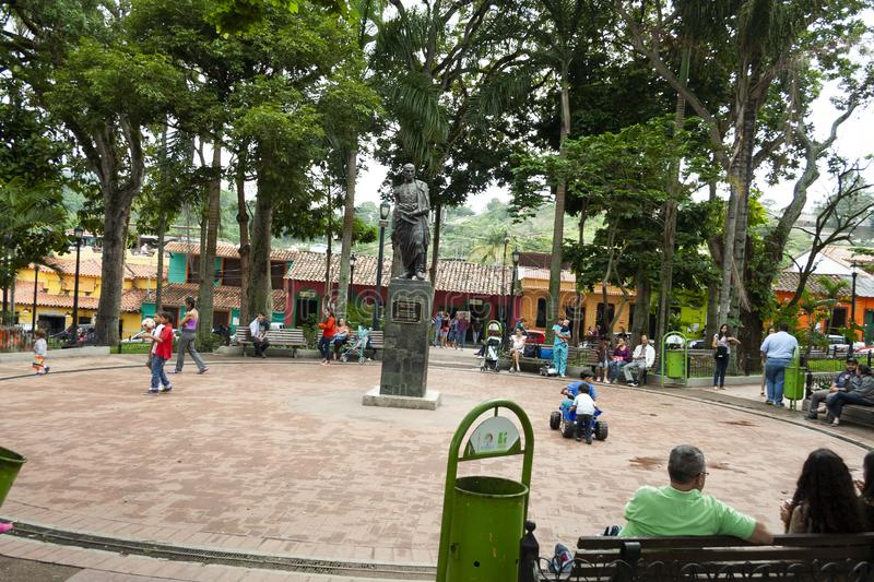 Iconic statue of Simon Bolivar in Plaza Bolivar in El Hatillo and people, children,women and men spending time playing and resting.  stock images