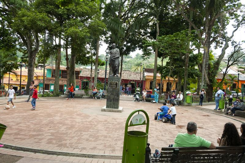 Iconic statue of Simon Bolivar in Plaza Bolivar in El Hatillo and people, children,women and men spending time playing and resting.  royalty free stock photo