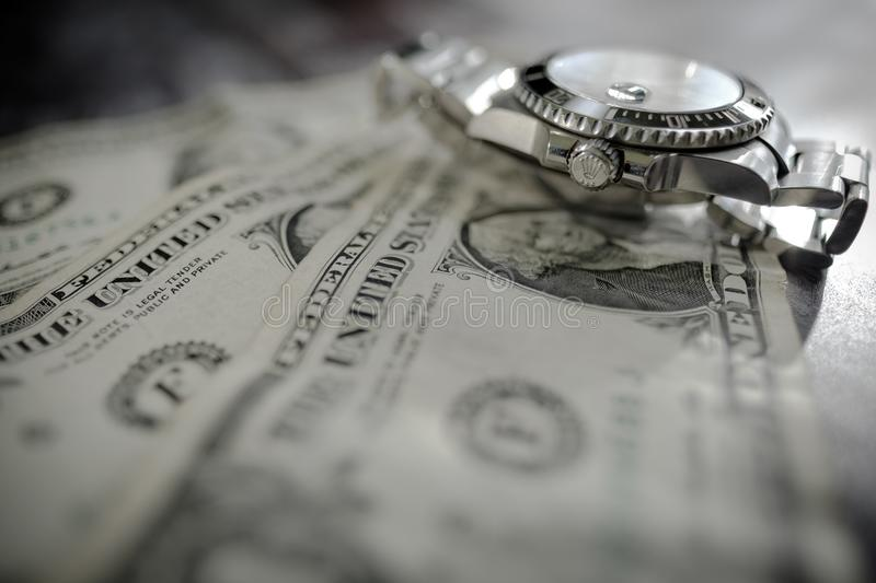 Iconic, swiss manufactured men`s automatic diving watch seen on used dollar bills. stock images