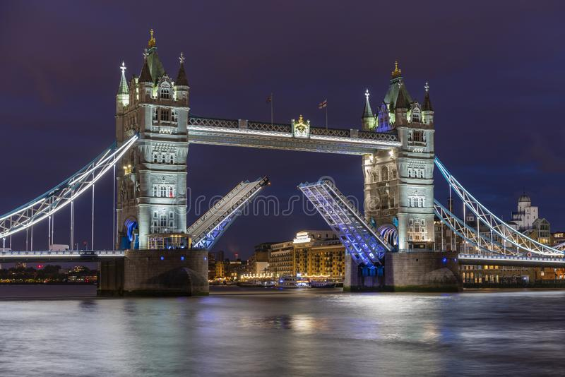 The iconic Tower Bridge in London at night, beautifully illuminated and with raised bascules stock photography