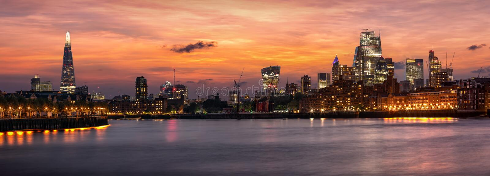 The iconic urban skyline of London, UK, after sunset time stock photo