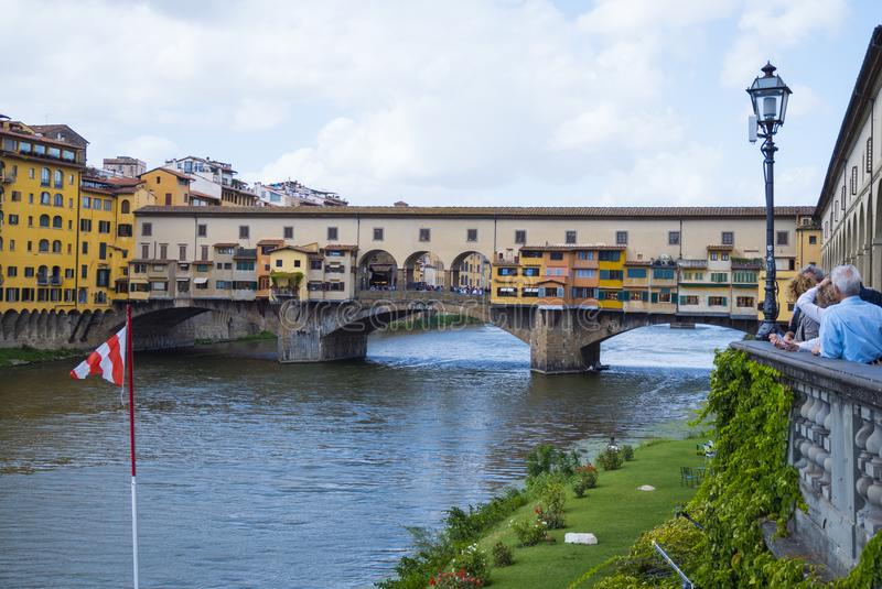 Iconic Vecchio Bridge in Florence over river Arno called Ponte Vecchio - FLORENCE / ITALY - SEPTEMBER 12, 2017. Iconic Vecchio Bridge in Florence over river Arno royalty free stock photo
