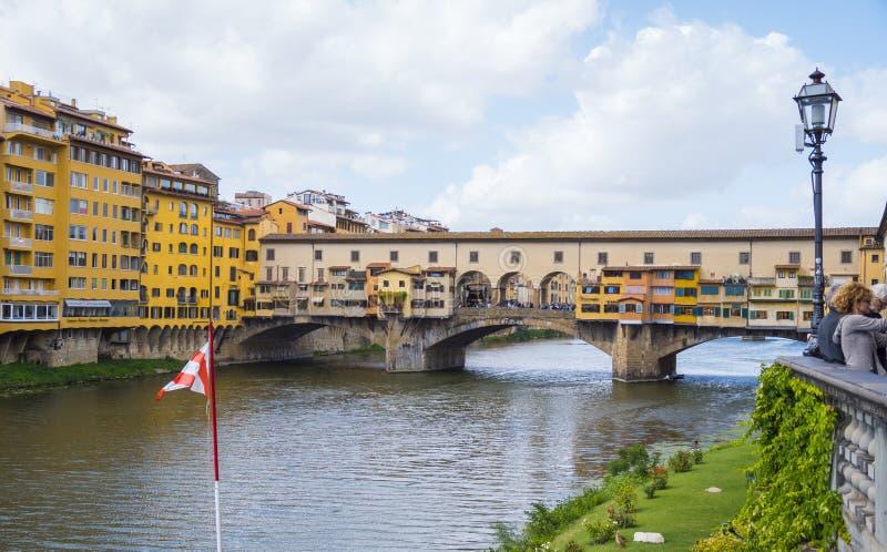 Iconic Vecchio Bridge in Florence over river Arno called Ponte Vecchio - FLORENCE / ITALY - SEPTEMBER 12, 2017. Iconic Vecchio Bridge in Florence over river Arno stock photo