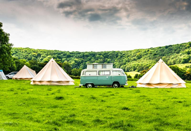 An iconic VW Camper or Kombi at a glamping site in the English countryside royalty free stock photography