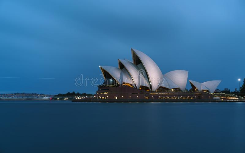 Iconic worlds ` buildings - Sydney Opera house in full glory at sunset brightly illuminated royalty free stock images