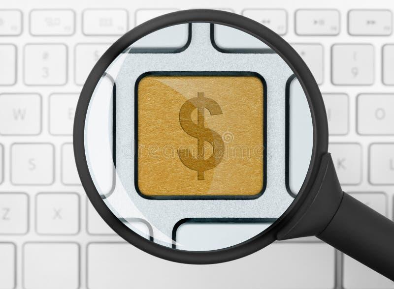 Icono del dólar debajo de la lupa fotografía de archivo