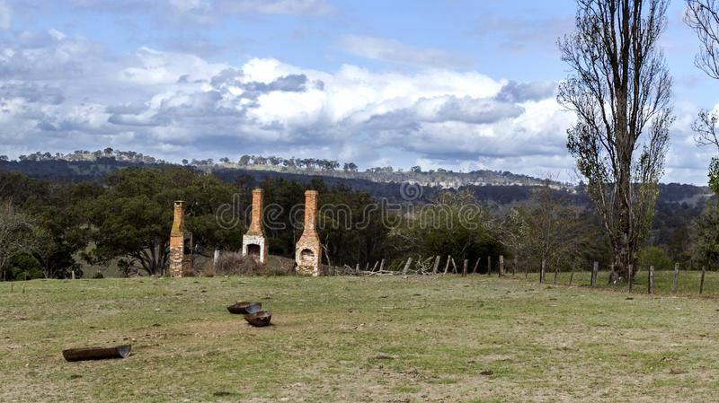 Icons of the Bygone Era. Ruins of three chimneys and fire places reminders of a glorious bygone era in the rural countryside of New England, in New South Wales royalty free stock photos