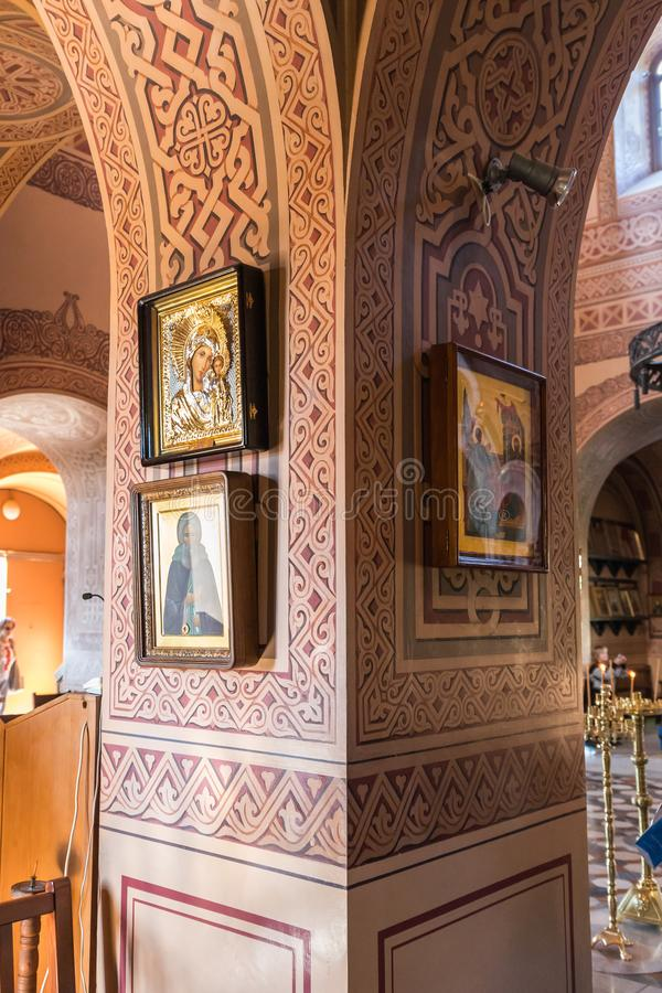 Icons hang on a pole in the interior of Church of Mary Magdalene in Jerusalem, Israel royalty free stock image