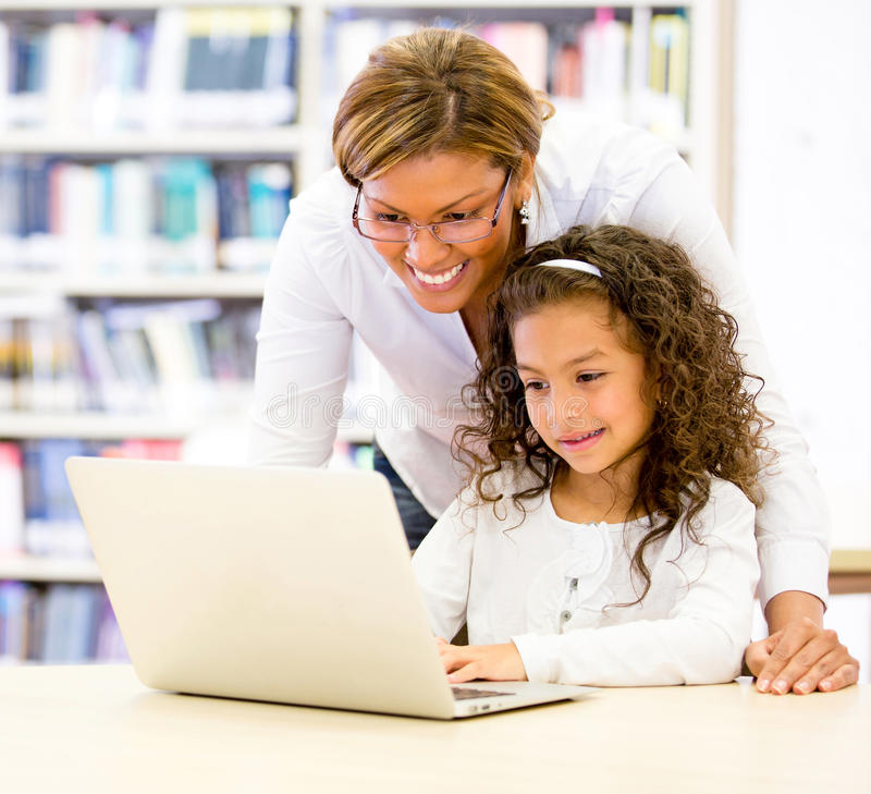 Download ICT teacher with a student stock photo. Image of joyful - 27908152