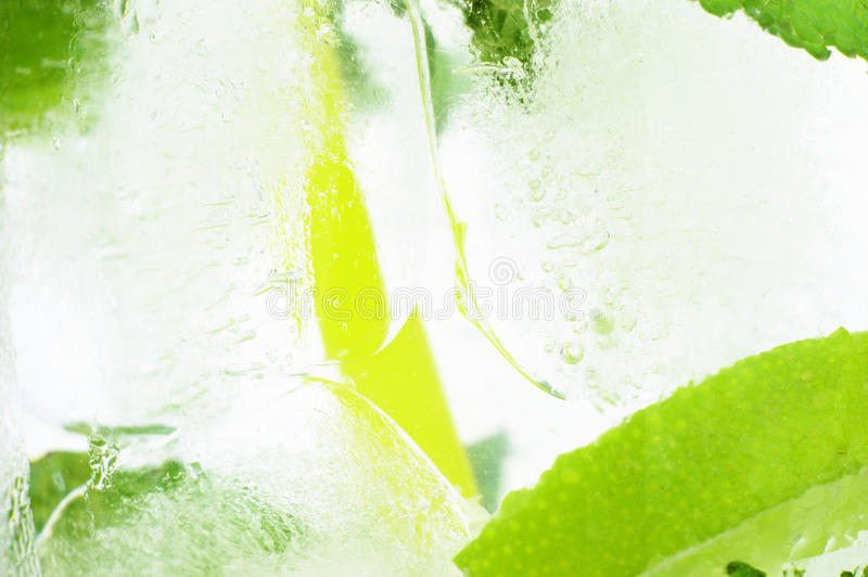 Icy background macro drink ice cubes mint limes royalty free stock photography