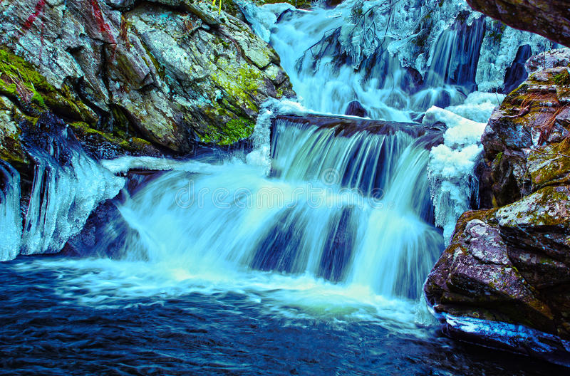 Icy Blue Waterfall. Edited photo of a Icy Blue Waterfall in Connecticut royalty free stock images